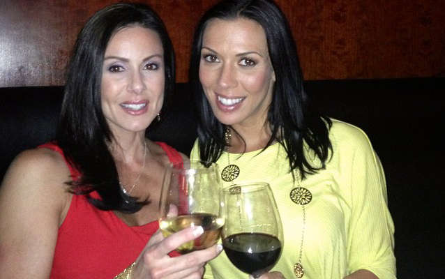 Kendra Lust and Rachel Starr drinking wine