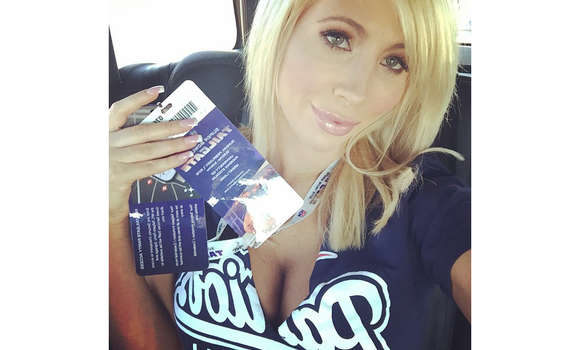 Tasha Reign flashes her Super Bowl Tickets